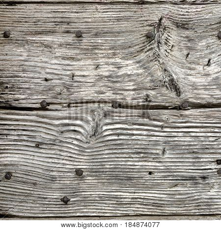 Old crackled wooden texture. Retro background. Closeup