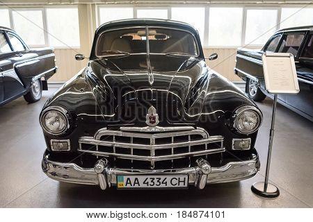 NOVI PETRIVTSI, UKRAINE - APRIL 2017: Classic car with closeup on headlights. The Museum of Old Vehicles in residence of ex-president of Ukraine Viktor Yanukovich.