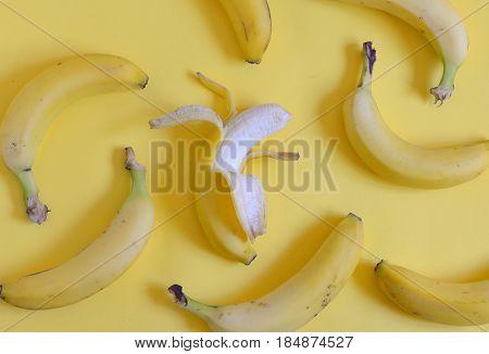 Ripe bananas set on yellow background, close up