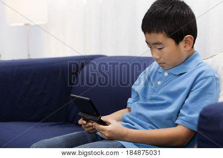 Korean boy playing video game
