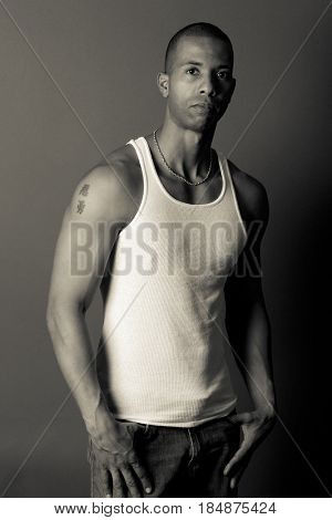 Serious African American man in tank-top