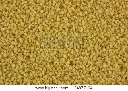 Raw organic couscous background, tasty, natural, top view