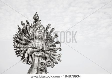 Guan Yin statue on sky background Guan Yin is famous god in Chinese