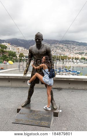 FUNCHAL PORTUGAL - SEPTEMBER 2 2016: The staue Christiano Ronaldo before the entry to the Museum CR 7 in Funchal on Madeira. Portugal