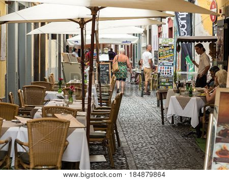 FUNCHAL MADEIRA PORTUGAL - SEPTEMBER 8 2016: Shops bars and restaurants in Santa Maria Street in Funchal town on Madeira Island. Portugal
