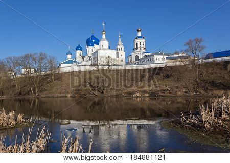 White-stone Monastery With Sky-blue Domes, Reflected In The Edge Of The Last Winter Ice