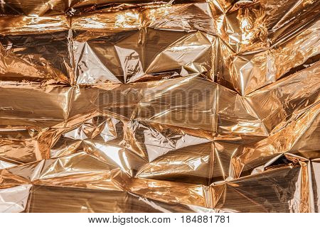 Golden crumpled foil texture for background, golden background