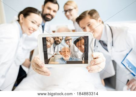 Doctors And Senior Patient