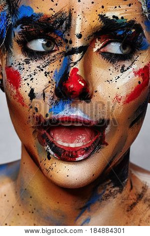 Beauty Portrait of young Woman with Clown Halloween Make-up