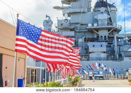HONOLULU, OAHU, HAWAII, USA - AUGUST 21, 2016:American flags at Missouri Battleship Memorial in Pearl Harbor Honolulu Hawaii, Oahu island of United States. National historic patriotic landmark.