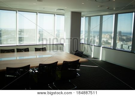 Empty table and chairs in modern office