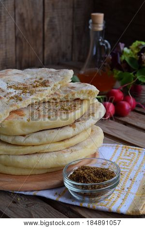 Pile Of Homemade Flat Bread With Lettuce, Onion And Radish On A Wooden Background. Mexican Flatbread