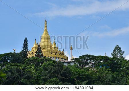 Golden pagoda famous places land mark in mangla shan state myanmar. Nearly china ishuangbanna SibsongbannaSipsong Panna