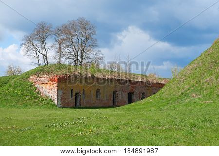 A fragment of fortifications of the old fortress with embrasures. Architecture fortification exterior