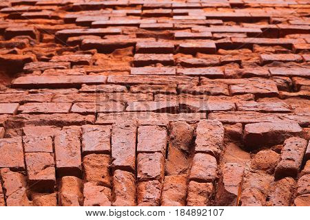Fragment of the brick wall of the fortress with embrasure. Architecture fortification exterior poster
