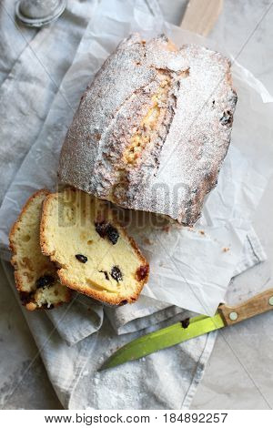 Raisin bread for breakfast on gray background. Raisin cake.