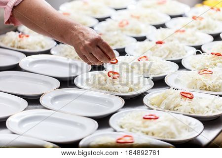 Cook Is Garnishing Dish