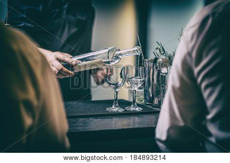 Bartender Serving Alcohol Drinks
