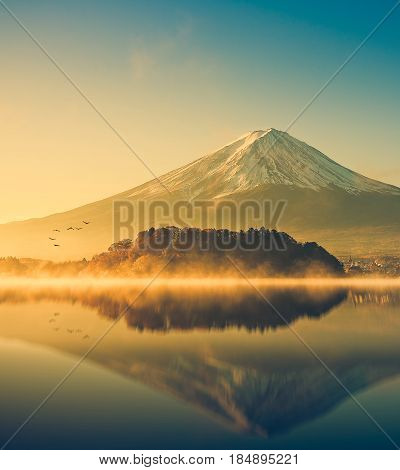 Mount fuji san at Lake kawaguchiko in japan. mt.fuji reflection on sunrise. vintage tone Mount fuji. Mount fuji in Japan on Sunrise. Mount fuji in kawaguchiko Japan. Mount fuji reflection at Japan.