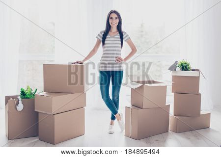 Young Pretty Lady Is Moving To New Place. She Is Satisfied, She Collected Her Belongings In Boxes