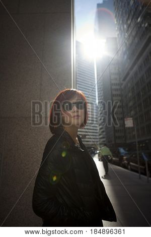 Korean woman walking on city sidewalk