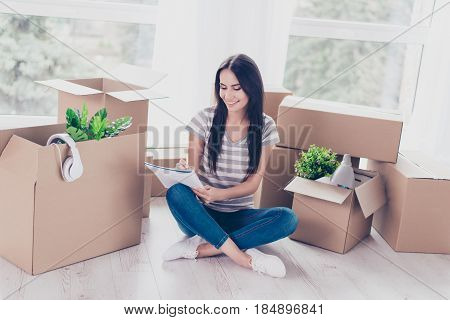 Home, Sweet Home! Cute Teen In Casual Clothes Is Sitting With Crossed Legs On The Floor Of Her New A