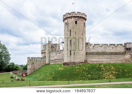 View of the medieval Warwick Castle tower and gatehouse from within the castle gardens. Warwick Warwickshire United Kingdom poster