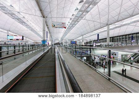 Hong Kong - December 28, 2013: Hong Kong International Airport (Chek Lap Kok Airport) with Passengers in Terminal 1