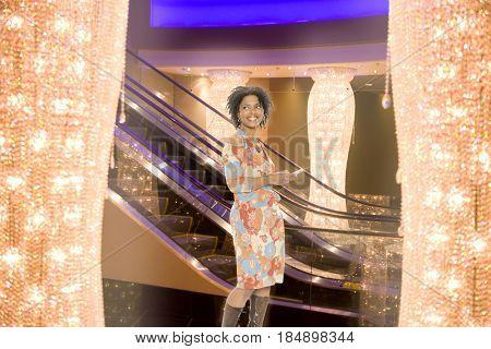 African American woman standing in night club