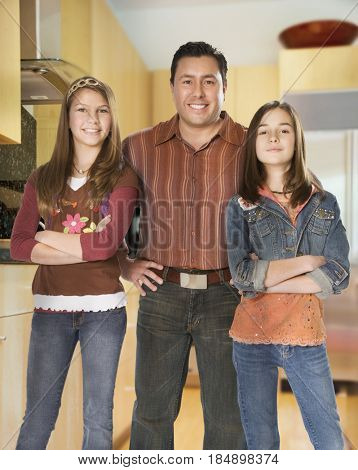 Father and daughters standing together