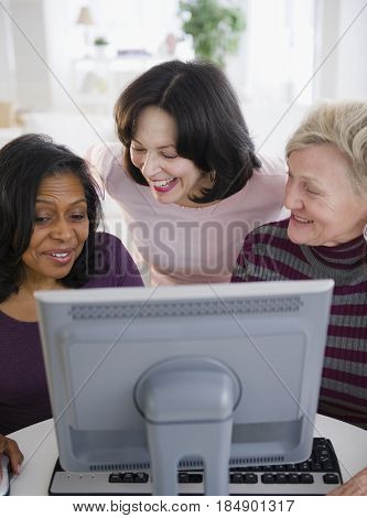 Friends using computer together