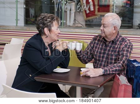 Senior Hispanic couple drinking coffee in cafe
