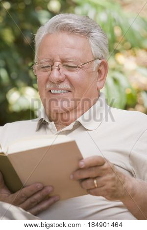 Senior Chilean man reading book