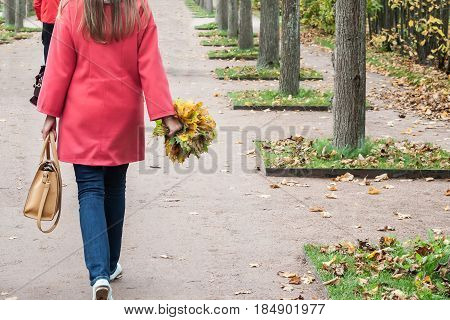 autumn bouquet in a hand of the person in the autumn afternoon