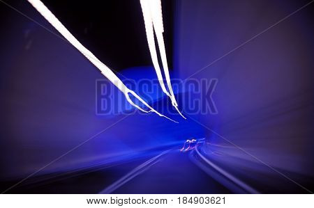 moving through a tunnel abstract with car lights poster