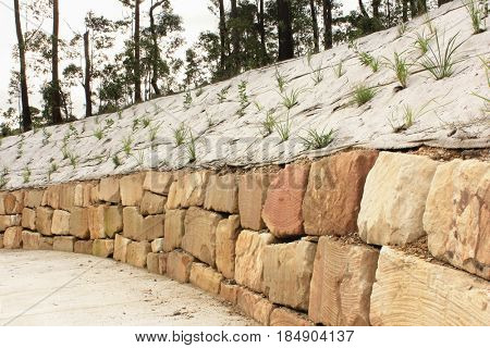 Sandstone retaining wall with erosion protection cloth
