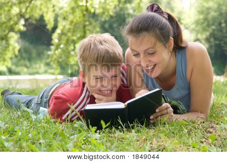 Mum And The Son Reads The Book
