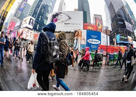 New York - Usa  April 22 2017 Times Square Moving People In Rainy Day