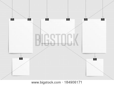 Poster template of a paper sheet. Collection empty paper frame mockup hanging with paper clip. Isolated on white background. Vector illustration.