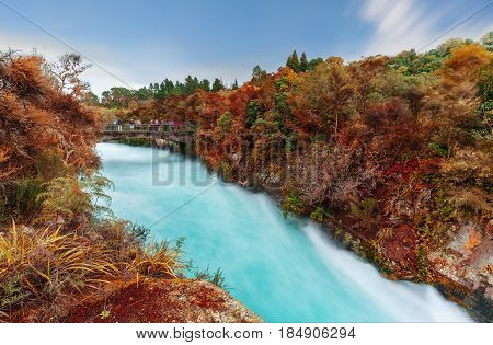 The Huka falls are the largest fast and powerful waterfalls on the Waikato River in Autumn located in Wairakei Park of Taupo North Island of New Zealand