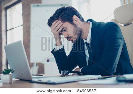 Young Tired, Ill, Overworked  Man In Formal Wear Sitting In Front Of Computer And Touching His Foreh