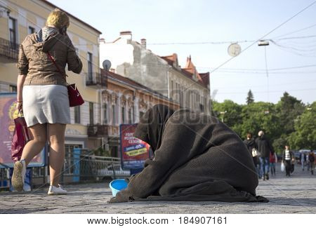 Uzhgorod,ukraine - May 03, 2017: Poor Old Woman Begging For Alms In The Street Of Uzhhorod, Ukraine