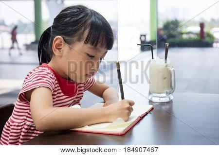 Asian Chinese Little Girl Doing Homework