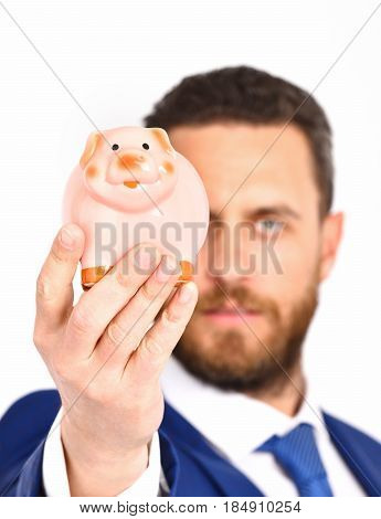 Businessman In Suit And Tie Holding Piggybank