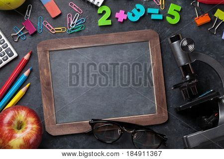 Supplies, apple and chalk board for your text. Back to school concept with copy space