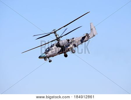 Attack helicopter is armed with rockets bombs guns and able to fight day and night