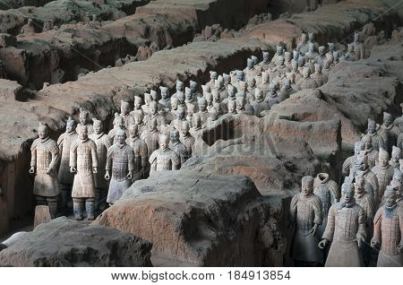 Xian China - August 6 2012: Ranks of Army Terracota Warriors in the archaeological site near Xian China