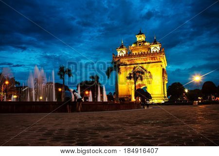 Vientiane, Laos. Patuxay park at night with illuminated Gate of Victory - famous landmark in Vientiane, Laos at sunset
