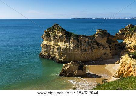 View of the scenic Praia dos Tres Irmaos in Alvor Algarve Portugal; Concept for travel in Portugal and explore Algarve
