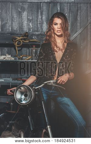 Sexy Biker In Erotic Shirt And Jeans Standing At Motorcycle